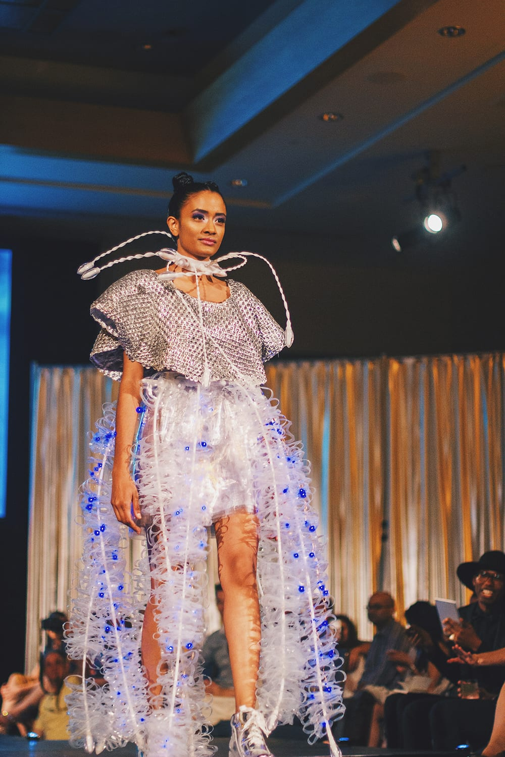 Model wearing recycled fashion at the Ecolution Fashion Show