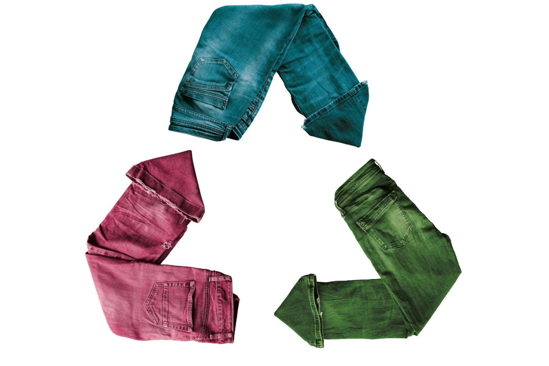 Three pairs of jeans laid on the ground to form the recycle symbol.
