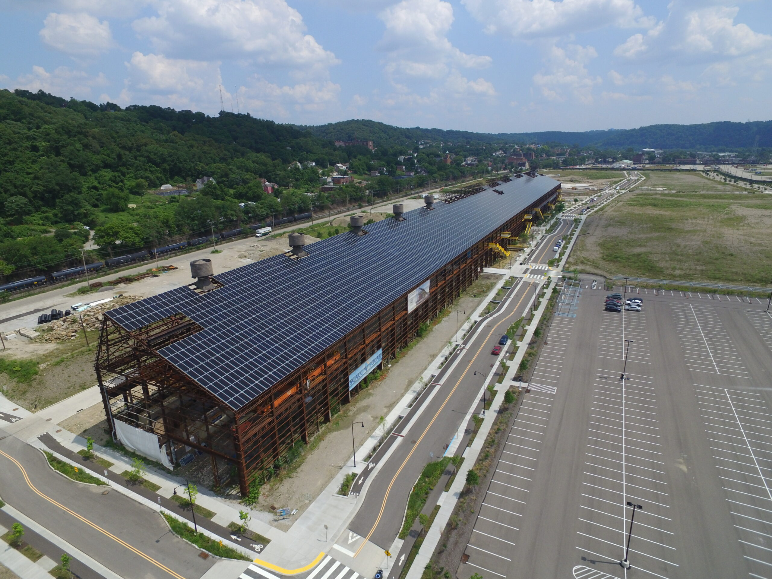 Sloped solar panels line the roof of Mill 19 in Hazelwood, Pennsylvania.